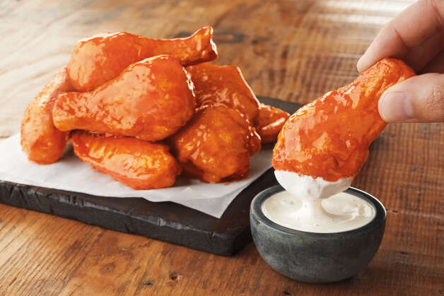 Buffalo Burnin' Hot bone-in wings at Pizza Hut: Breaded chicken wings, deep-fried and tossed in your favorite sauce, wrapped in foil and delivered warm to your door.Total calories: 240 (for two wings). Fat grams: 14. Sodium: 800 mg. Dietary fiber: 1. Carbs: 19 g. Protein: 8 g. Manufacturer's suggested retail price: eight bone-in wing pieces for $6. Boneless wings are eight for $5.What Hoffman says: I went with Buffalo Burnin' Hot because … the things I do for you dear readers. I'm your gastrointestinal crash-test dummy. Find out Hoffman's final verdict on the saucy wings.  Photo: -- / Jack Andersen