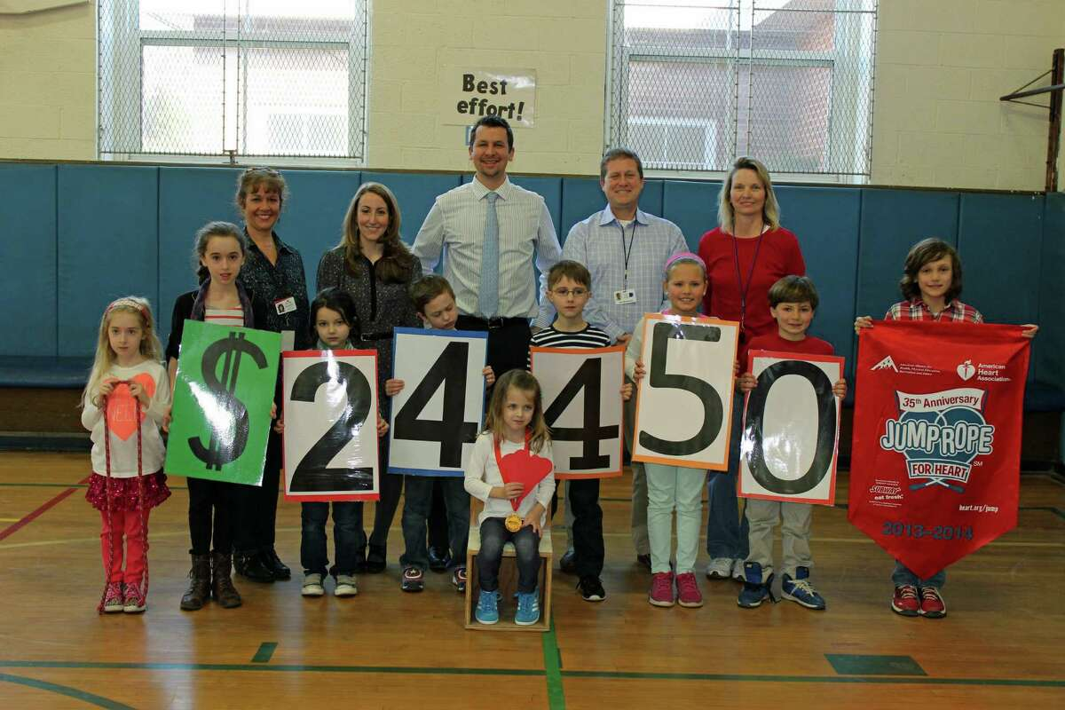 Royle Elementary School in Darien set a new record for funds raised during the annual Jump Rope for Heart. Seated, Tanner Shanley, the school's top fundraiser. Middle row from left, Emma St. Jean, Abby St. Jean, Emma Van Loan, Connor Hardy, Jake Blyth, Molly McGuckin, Briggs McGuckin and Andrew Marcula. Top row, Susan McGrath, of the American Heart Association; Vice Principal Natasha Torre; Principal Keith Margolus; Physical Education Director Chris Manfredonia; and PE teacher Jill Cardamone.