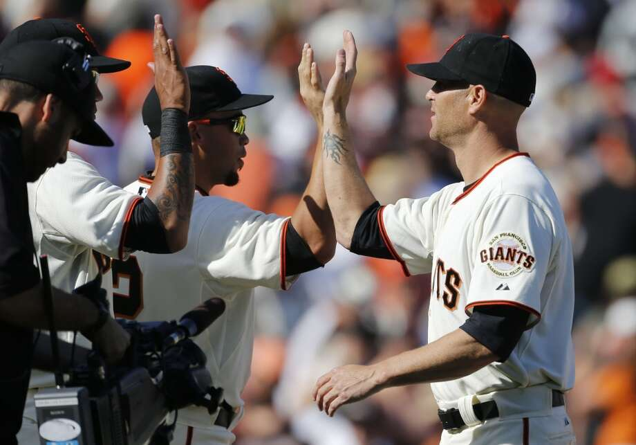 Giants starting pitcher Tim Hudson, (17), right,  gets the win as the as the San Francisco Giants beat the Arizona Diamondback 7-3, during their home opener at AT&T Park on Tuesday April 8, 2014, in San Francisco, Calif. Photo: The Chronicle