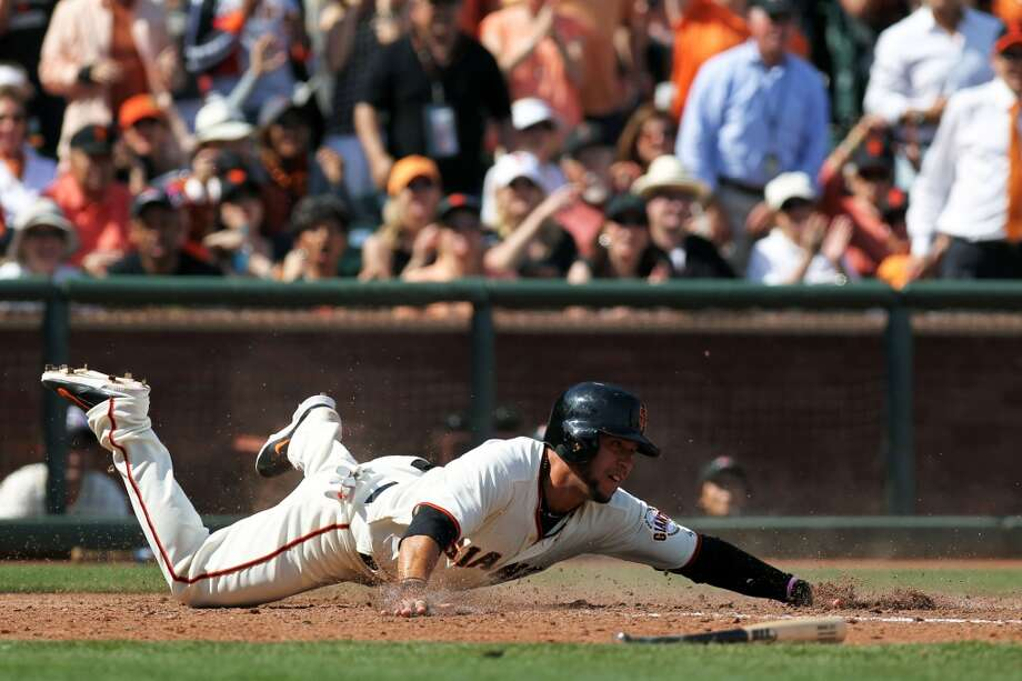 San Francisco Giants Gregor Blanco (7) slides safely into home plate on a Brandon Crawford (not pictured) double in the fifth inning of their baseball game with the Arizona Diamondbacks at AT&T Park. Photo: Lance Iversen, Reuters