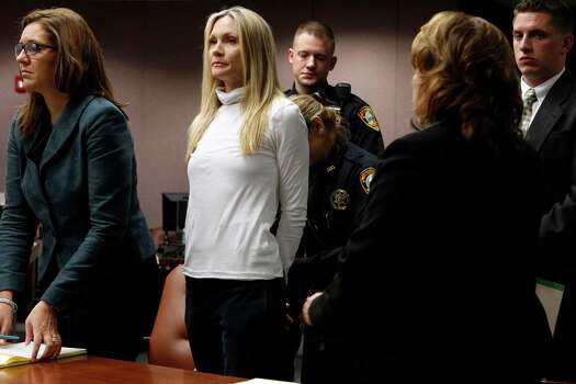 """Former """"Melrose Place"""" actress Amy Locane-Bovenizer, 40, second from left, of Hopewell Township, N.J. is taken into custody after jurors in Somerville, N.J.,  convicted her of vehicular homicide.   At left is her attorney Ellen Torregrossa-O'Connor.      (AP Photo/Robert Sciarrino, pool) Photo: Sciarrino, Robert"""