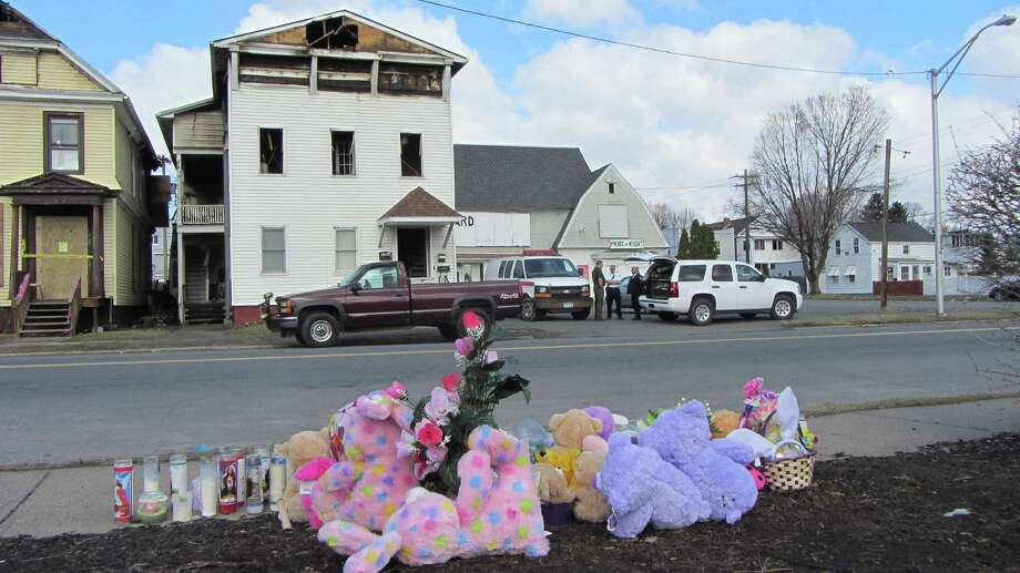 Investigators were back at a Sixth Avenue home in Troy where a 19-year-old pregnant woman died on April 3. It was unclear why city detectives, police, firefighters and state fire investigators were back at Vanessa Milligan's home.  (Bob Gardinier / Times Union)