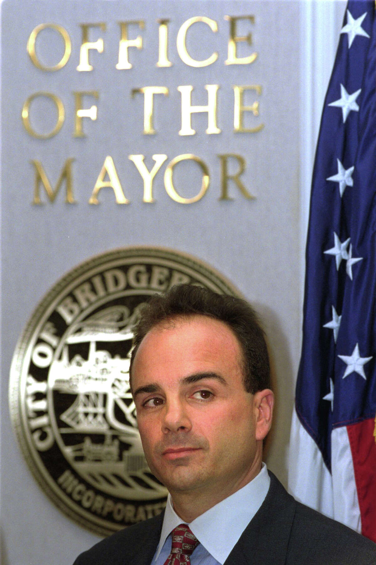 Bridgeport Mayor Joseph P. Ganim looks on Oct. 31st, 2001, during a press conference outside the Office of the Mayor at City Hall Annex on the day a federal grand jury indicted him on 24 felony charges including racketeering, bribery, extortion, mail fraud and tax evasion.