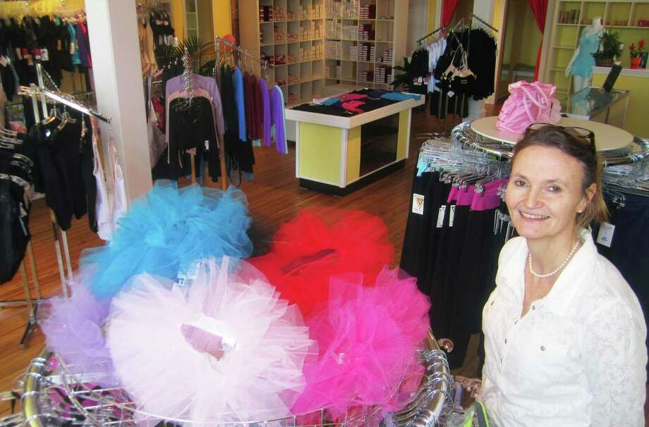 Monica Harcken displays a shop chock full of dancers' apparel at Monica's Corner in New Milford. April 2014 Photo: Norm Cummings / The News-Times