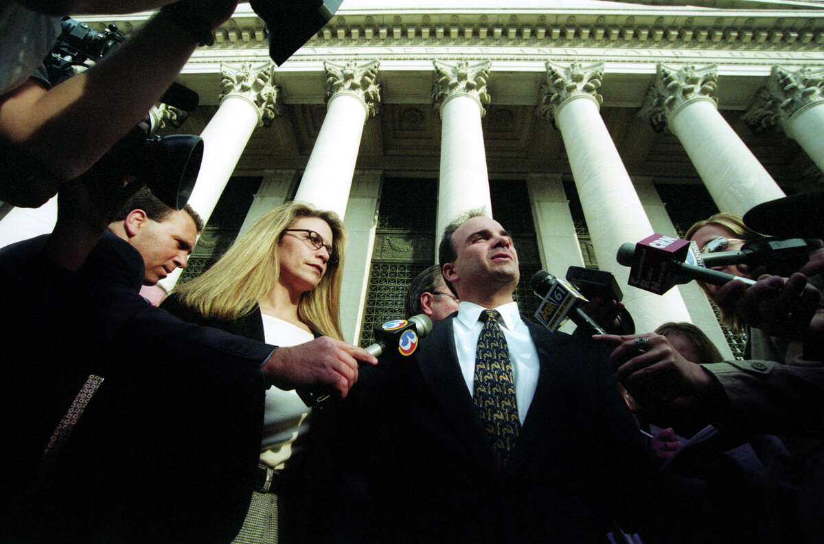 Mayor Joseph Ganim with his wife Jennifer surrounded by media in front of U.S. District Court in New Haven, Conn. on March 18th, 2003. The next day, Ganim was found guilty on 16 of 21 federal corruption charges.