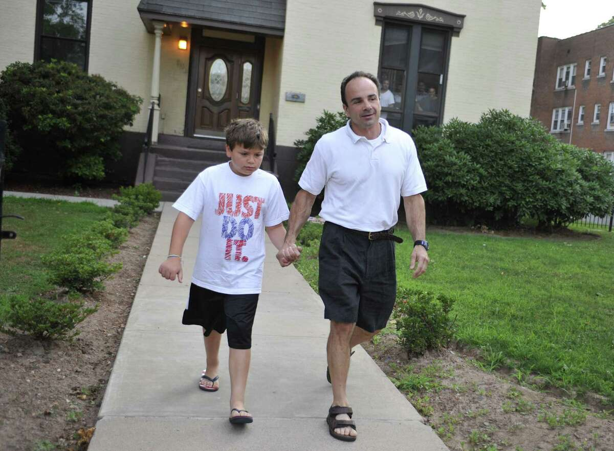 Former Bridgeport Mayor Joseph Ganim, right, with his son Robert, leaves a halfway house in Hartford, Conn., Monday, July 19, 2010. Ganim was sentenced to nine years in prison in 2003 for corruption.