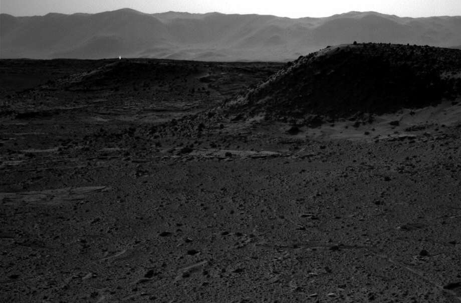 This image taken by NASA's Curiosity Mars rover on April 3 includes a bright spot, in the upper left, which has yet to be explained. Photo: Associated Press