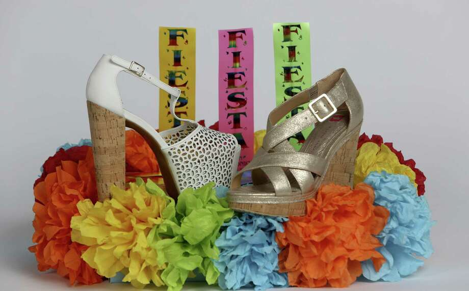 With Fiesta growing to 18 days, that's a lot of platform wedges, flats and single-sole (not platform) shoes that will get fashionistas through A Night in Old San Antonio, Fiesta Oyster Bake, a masked ball, arts fairs, music festivals and the Tastes of New Orleans and the Northside. Here are our favorite looks for the spring-into-summer season. --Read Fashion Writer Michael Quintanilla's full story on ExpressNews.com. See readers' Fiesta kicks and show us your shoes! Submit a photo here. Left: White laser-cut Jessica Simpson chunky cork-heeled sandal, $98, at Dillard's North Star Mall. Right: Flecked metallic gold cork wedge by Elaine Turner, $288, at Elaine Turner Boutique. / ©2013 San Antonio Express-News