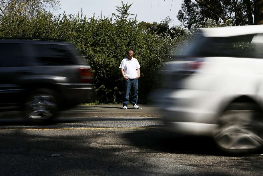 Sunset District resident Wesley Dere watches cars navigate bumpy Kezar Drive. Dere says his car has been knocked out of alignment twice. Photo: Beck Diefenbach, Special To The Chronicle
