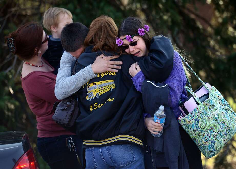 Parents and students gather near Franklin Regional High School in Murrysville, Pa., after 21 students and a security guard were wounded in an attack at the suburban school. Photo: Sean Stipp, Associated Press