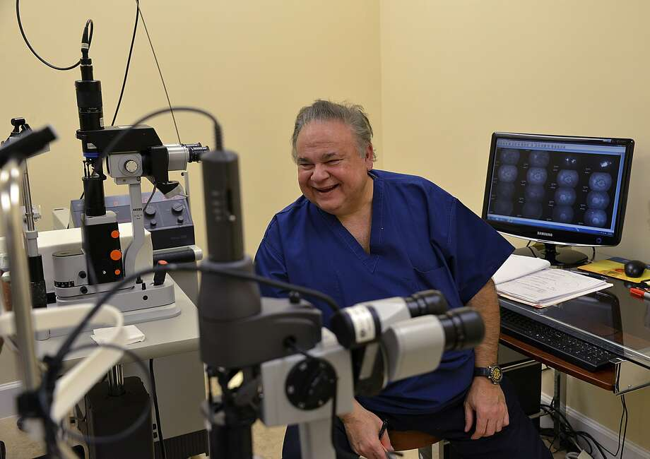 Dr. Salomon Melgen jokes with a patient at his office in Port St. Lucie, Florida, U.S., on Thursday, March 21, 2013. Melgen, who specializes in injections for age-related macular degeneration, was paid $20,827,341 by Medicare in 2012, or 64 times the average in his field, according to data in a report by the Centers for Medicare and Medicaid Services released on April 9, 2014. Photographer: Mark Elias/Bloomberg *** Local Caption *** Salomon Melgen Photo: Mark  Elias, Bloomberg