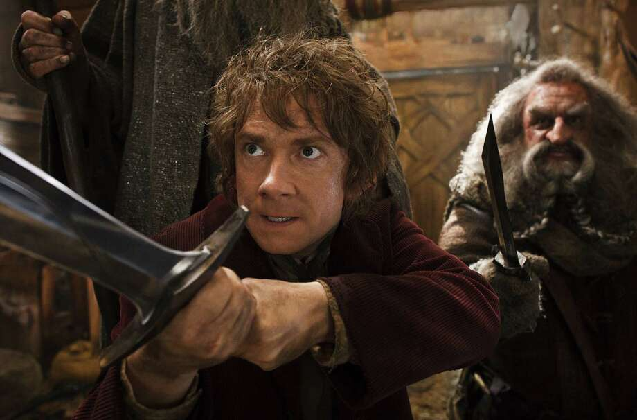 "This image released by Warner Bros. Pictures shows Martin Freeman, left, and John Callen in a scene from ""The Hobbit: The Desolation of Smaug.""The Hobbit: The Desolation of Smaug"" continued to top the box office, landing at No. 1 over the Christmas holiday for the third weekend in a row. (AP Photo/Warner Bros. Pictures, Mark Pokorny) ORG XMIT: NY111 Photo: Mark Pokorny / Warner Bros. Pictures"