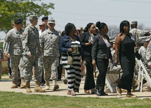 KILEEN, TX - APRIL 9:  Invited guests arrive before U.S. President Barack Obama speaks at a memorial for victims of last week's shooting on the U.S. Army post at Fort Hood military base on April 9, 2014 in Kileen, Texas. During the shooting rampage on April 2, Army Spc. Ivan Lopez killed three people and wounded 16 others before taking his own life. Photo: Erich Schlegel, Getty Images / 2014 Getty Images