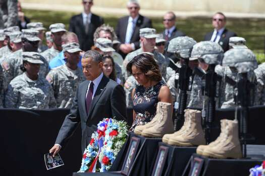 President Barack Obama and first lady Michelle Obama attend a memorial ceremony for three soldiers slain at a mass shooting carried out by Spc. Ivan Lopez, at Fort Hood, Texas, April 9, 2014. Obama last visited the base in 2009 for a memorial for another mass shooting, carried out by Maj. Nidal Malik Hasan. Photo: DOUG MILLS, New York Times / NYTNS