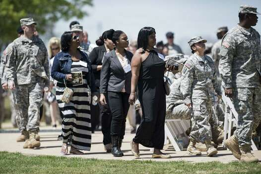 People arrive for a memorial service at Fort Hood April 9, 2014 in Texas. US President Barack Obama attended a memorial service for the three people killed and 16 wounded during last weeks shooting at the post by Army Specialist Ivan Lopez who later took his own life.   AFP PHOTO/Brendan SMIALOWSKIBRENDAN SMIALOWSKI/AFP/Getty Images Photo: BRENDAN SMIALOWSKI, AFP/Getty Images / 2014 Brendan Smialowski