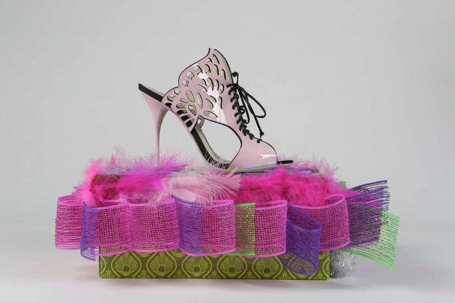 Laser cut winged lace up heel in pastel pink by Sophia Webster, $490, at Julian Gold. Photo: Helen L. Montoya, San Antonio Express-News / ©2013 San Antonio Express-News