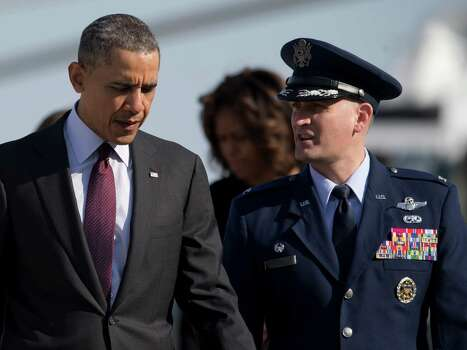 President Barack Obama walks with Colonel William M. Knight from Marine One to board Air Force One, Wednesday, April 9, 2014, in Andrews Air Force Base, Md., as he and first lady Michelle Obama, center in the background, travel to Texas to attend Democratic fundraising events and to visit Fort Hood for a ceremony honoring those injured and killed there last week. (AP Photo/Carolyn Kaster) Photo: Carolyn Kaster, Associated Press / AP