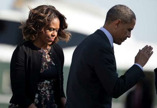 President Barack Obama salutes as he and and first lady Michelle Obama board Air Force One, Wednesday, April 9, 2014, in Andrews Air Force Base, Md., as they travel to Texas to attend Democratic fundraising events and to visit Fort Hood for a ceremony honoring those injured and killed there last week. (AP Photo/Carolyn Kaster) Photo: Carolyn Kaster, Associated Press / AP