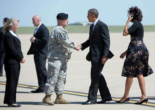 President Barack Obama and first lady Michelle Obama are greeted by Fort Hood commander Lt. Gen. Mark A. Milley, and is wife Hollyanne Milley as they arrive at Robert Gray Army Air Field in Killeen, Texas, Wednesday, April 9, 2014, as they travel to Fort Hood for a memorial service for those killed there in a shooting last week. (AP Photo/Carolyn Kaster) Photo: Carolyn Kaster, Associated Press / AP