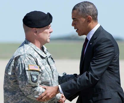 President Barack Obama is greeted by Fort Hood, commander Lt. Gen. Mark A. Milley as he arrives on Air Force One at Robert Gray Army Air Field in Killeen, Texas, Wednesday, April 9, 2014, en route to Fort Hood for a memorial service for those killed there in a shooting last week. (AP Photo/Carolyn Kaster) Photo: Carolyn Kaster, Associated Press / AP