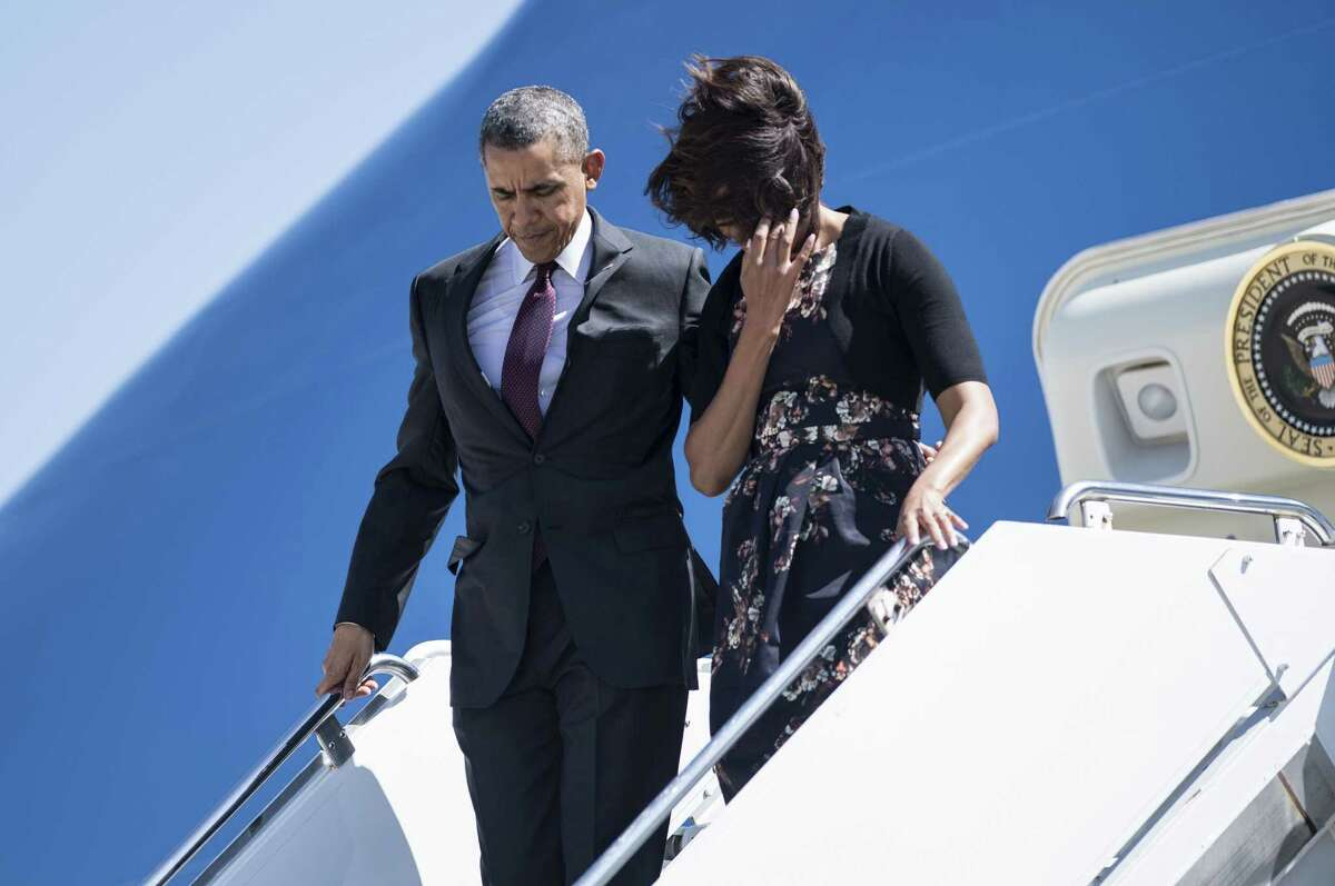 US President Barack Obama and First Lady Michelle Obama arrive at Robert Gray Army Airfield on April 9, 2014 in Killeen, Texas. Obama is in Texas to first attend a memorial service for the victims of last week's shooting at Fort Hood and then attend two fund raisers for the Democratic National Committee, the Democratic Congressional Campaign Committee and the Democratic Senatorial Campaign Committee. AFP PHOTO/Brendan SMIALOWSKIBRENDAN SMIALOWSKI/AFP/Getty Images