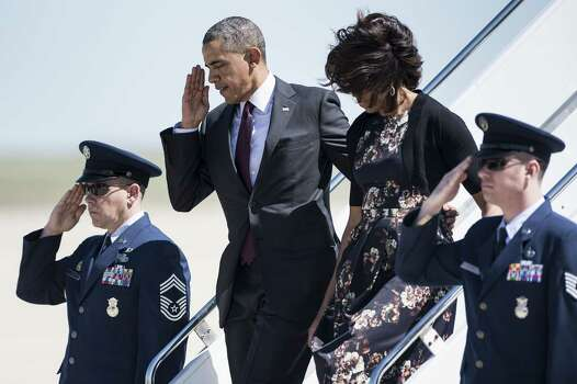 US President Barack Obama and First Lady Michelle Obama arrive at Robert Gray Army Airfield on April 9, 2014 in Killeen, Texas. Obama is in Texas to first attend a memorial service for the victims of last week's shooting at Fort Hood and then attend two fund raisers for the Democratic National Committee, the Democratic Congressional Campaign Committee and the Democratic Senatorial Campaign Committee.  AFP PHOTO/Brendan SMIALOWSKIBRENDAN SMIALOWSKI/AFP/Getty Images Photo: BRENDAN SMIALOWSKI, AFP/Getty Images / 2014 Brendan Smialowski