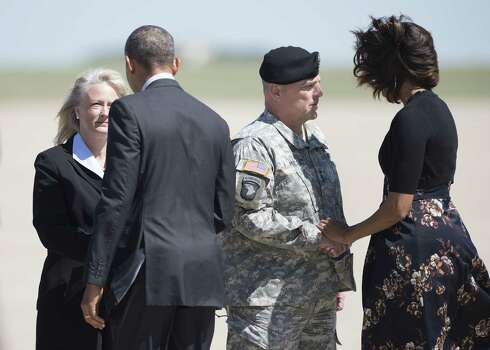 US President Barack Obama  (2L) and US First Lady Michelle Obama (R) are greeted by Army Lt. General Mark Milley (2R) his wife Hollyanne Milley (L) at Robert Gray Army Airfield on April 9, 2014 in Killeen, Texas. Obama is in Texas to first attend a memorial service for the victims of last week's shooting at Fort Hood and then attend two fund raisers for the Democratic National Committee, the Democratic Congressional Campaign Committee and the Democratic Senatorial Campaign Committee.  AFP PHOTO/Brendan SMIALOWSKIBRENDAN SMIALOWSKI/AFP/Getty Images Photo: BRENDAN SMIALOWSKI, AFP/Getty Images / 2014 Brendan Smialowski