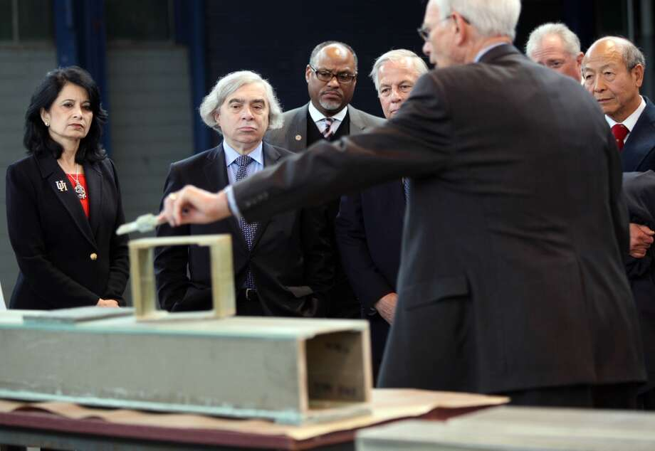 From the left, Dr. Renu Khator, chancellor of the University of Houston; U.S. Energy Secretary Ernest Moniz; Jarvis Hollingsworth, chairman of the UH System Board of Regents; and Congressman Gene Green tour the National Wind Energy Center at the University of Houston's Energy Research Park in March 2014. Photo: Mayra Beltran, Houston Chronicle