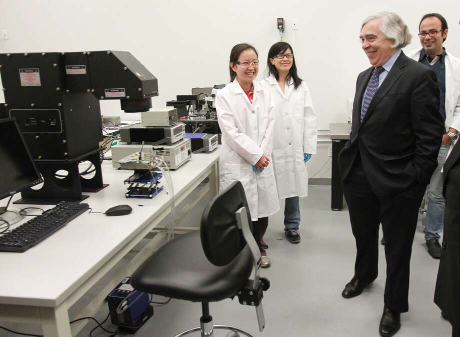 Students Ying Gao and Yao Yao meet U.S. Energy Secretary Ernest Moniz during his tour of the Energy Device Fabricator Laboratory at the University of Houston's Energy Research Park in March 2014. Photo: Mayra Beltran, Houston Chronicle