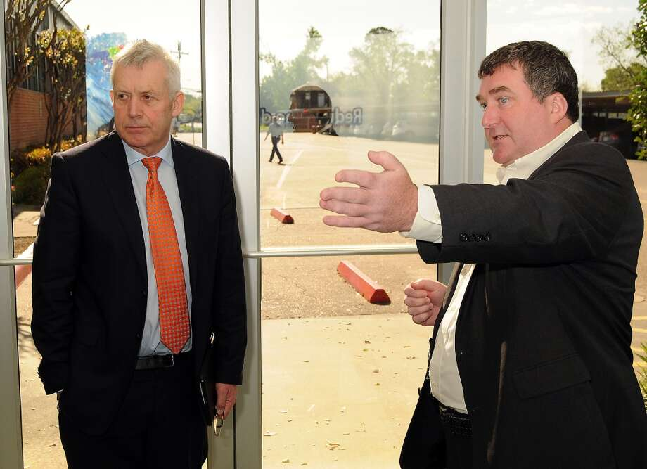 Shay Curran (right), founder of C-Voltaics, gives a tour of his company's facility to Ireland's Minister of State Fergus O'Dowd at the University of Houston's Energy Research Park in April 2014. Photo: Dave Rossman, For The Houston Chronicle