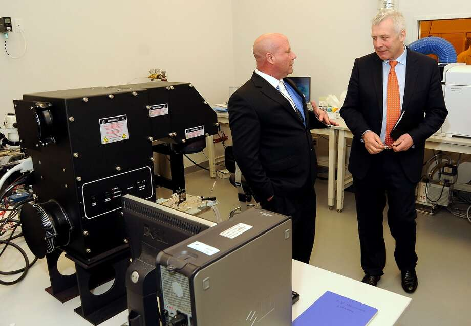T. J. Wainerdi (left), University of Houston's Energy Research business director, at left, gives a tour to Ireland's Minister of State Fergus O'Dowd at the University of Houston's Energy Research Park in April 2014. Photo: Dave Rossman, For The Houston Chronicle