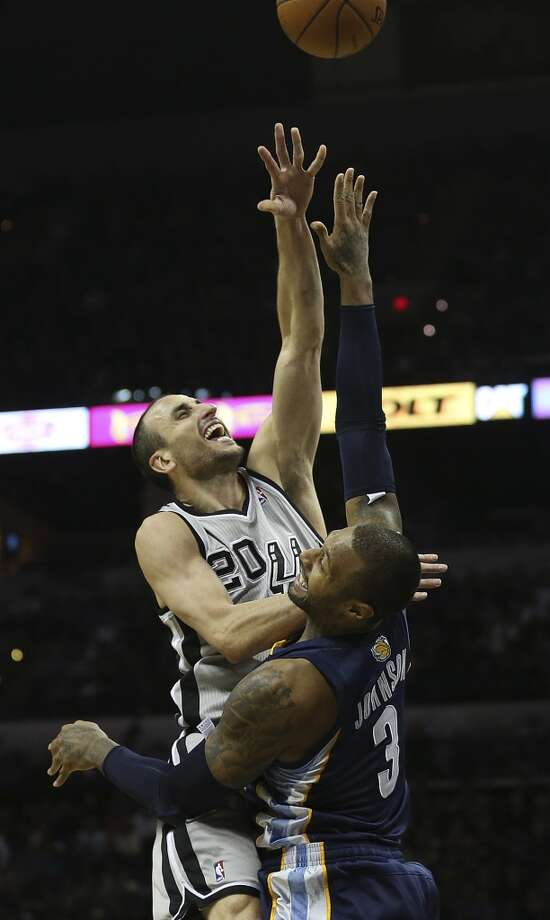 San Antonio Spurs' Manu Ginobili is fouled by Memphis Grizzlies' James Johnson during the second half at the AT&T Center, Sunday, April 6, 2014. The Spurs won 112-92. Photo: Jerry Lara, San Antonio Express-News