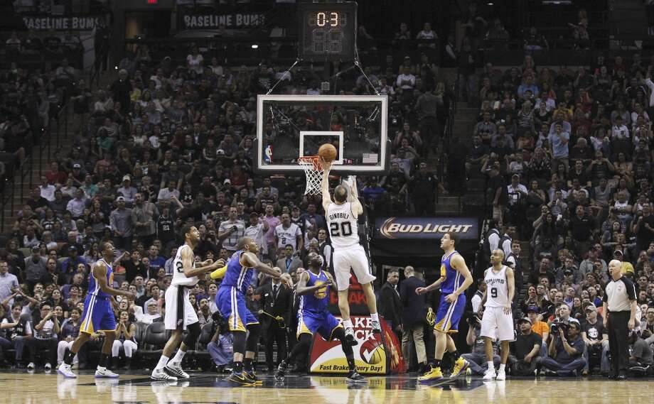 Spurs' Manu Ginobili (20) puts back a shot with less than a second left in the half against the Golden State Warriors at the AT&T Center on Wednesday, Apr. 2, 2014. Photo: Kin Man Hui, San Antonio Express-News