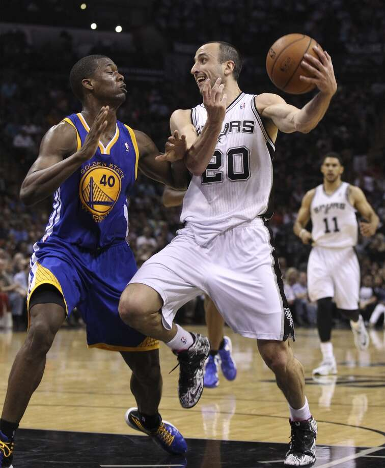 Spurs' Manu Ginobili (20) looks to pass against Golden State Warriors' Harrison Barnes (40) in the second half at the AT&T Center on Wednesday, Apr. 2, 2014. Spurs defeated the Warriors, 111-90. Photo: Kin Man Hui, San Antonio Express-News