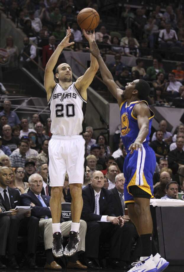 Spurs' Manu Ginobili (20) shoots a three against Golden State Warriors' Jordan Crawford (55) in the first half at the AT&T Center on Wednesday, Apr. 2, 2014. Photo: Kin Man Hui, San Antonio Express-News