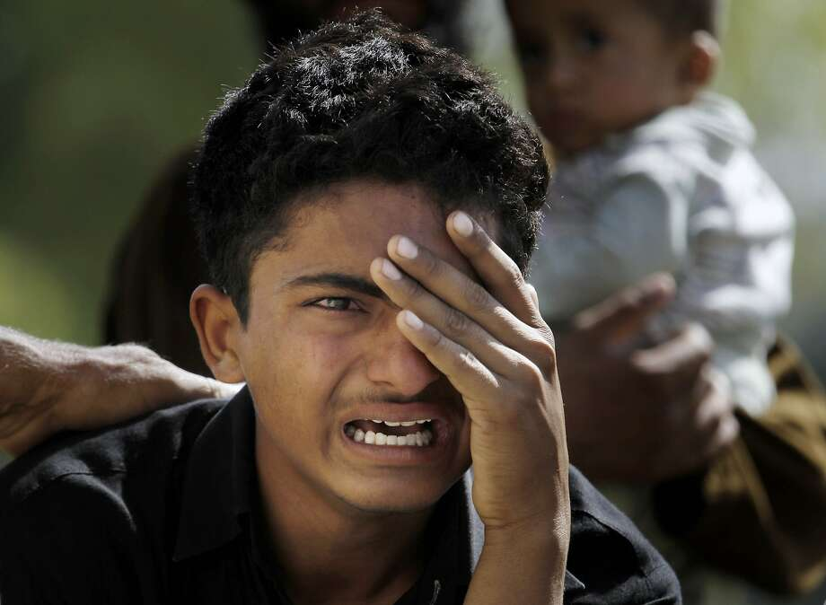 A Pakistani boy mourns the death of a family member, who was the victim of a bomb blast, outside a morgue at a hospital in the capital, Islamabad. Photo: Anjum Naveed, Associated Press