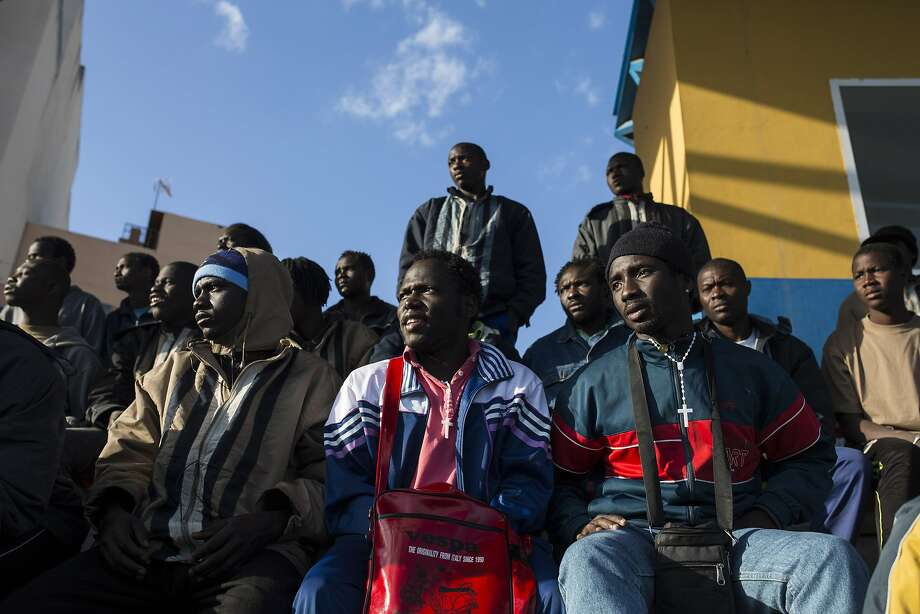 Africans watch a soccer match at a center for migrants at the Spanish enclave of Melilla, which offers one of the only land routes between the world's richest and poorest continents. Photo: Santi Palacios, Associated Press