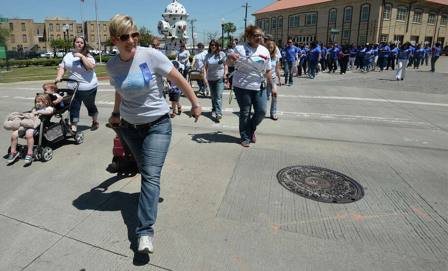 Several supporters, victims and officials walked Beaumont's Main street chanting about child abuse on Monday. Before the walk, several speeches were given by officials and victims at the Beaumont Fire Museum.  Photo taken Wednesday, April 09, 2014 Guiseppe Barranco/@spotnewsshooter Photo: Guiseppe Barranco, Photo Editor