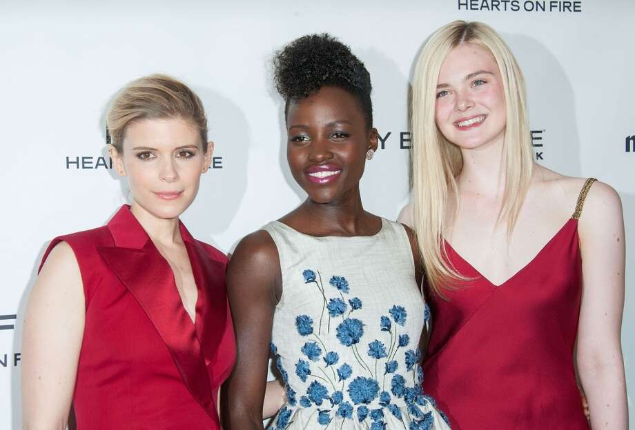(L-R) Actresses Kate Mara, Lupita Nyong'o and Elle Fanning arrive at the Marie Claire's Fresh Faces Party at Soho House on April 8, 2014 in West Hollywood, California. Photo: Valerie Macon, Getty Images