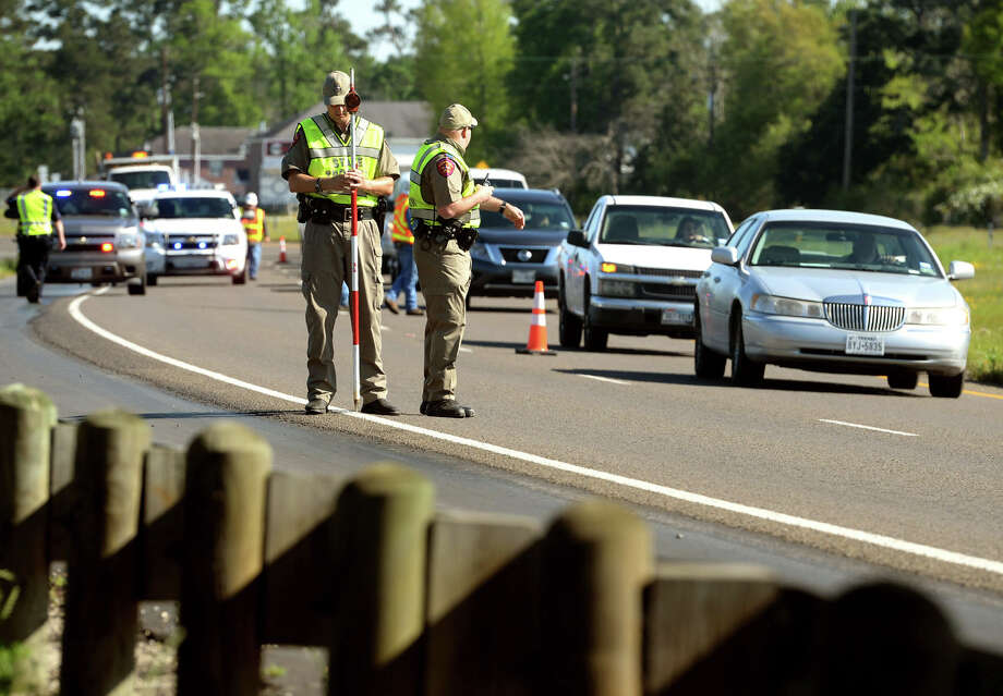 State Troopers Heath White, left, and Nathan Pierce assist in an accident reconstruction at the U.S. 69 and U.S. 96 interchange in Lumberton on Wednesday. The reconstruction stems from the February wreck that killed Connely Burns, 20; her unborn child; and Burns' 15-year-old-sister Courtney Sterling.
