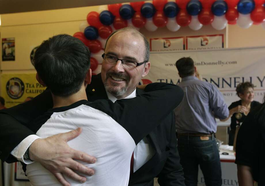 Gubernatorial candidate Tim Donnelly hugs his son Daniel at the California Republican Party spring convention in Burlingame, Calif. on Saturday, March 15, 2014. Photo: Paul Chinn, The Chronicle