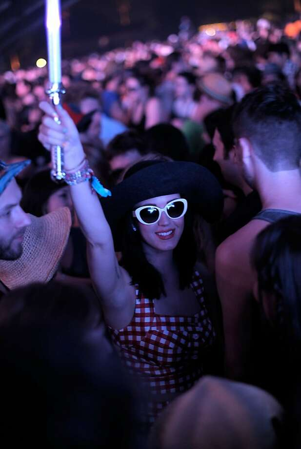 INDIO, CA - APRIL 15: Singer Katy Perry watches Sleigh Bells during Day 1 of the Coachella Valley Music & Arts Festival 2011 held at the Empire Polo Club on April 15, 2011 in Indio, California.