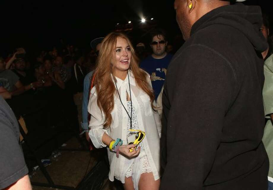 Lindsay Lohan in the audience during day 3 of the 2012 Coachella Valley Music & Arts Festival at the Empire Polo Field on April 15, 2012 in Indio, California. (Christopher Polk / Getty Images for Coachella)