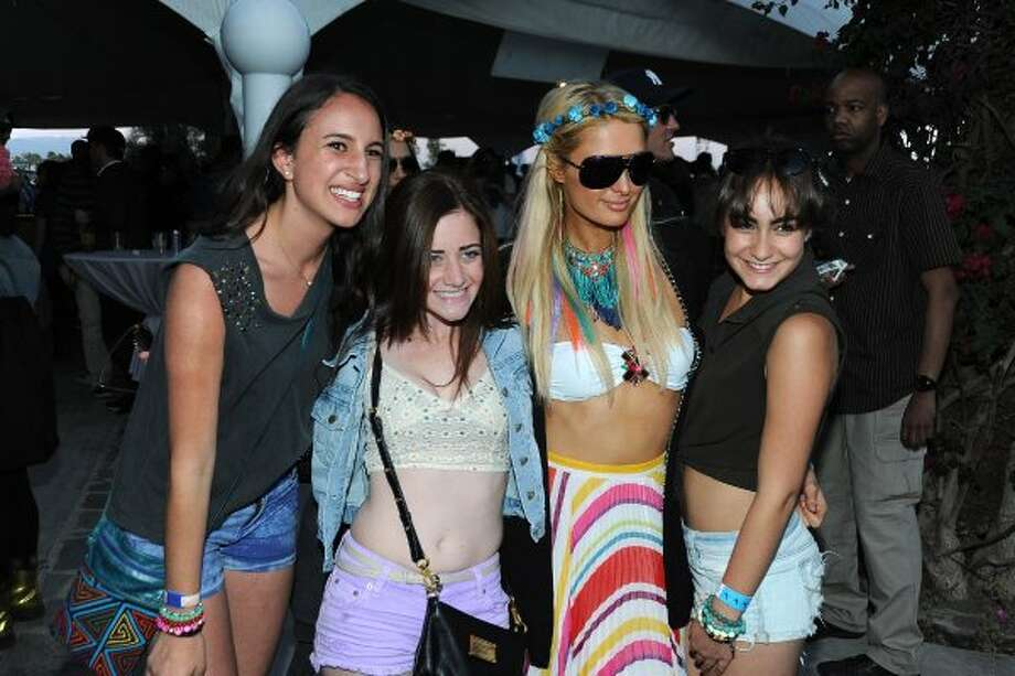 Paris Hilton (2nd from R) and guests attend Day 2 of the 2012 Coachella Valley Music & Arts Festival held at the Empire Polo Club on April 14, 2012 in Indio, California. (Frazer Harrison / Getty Images for Coachella)