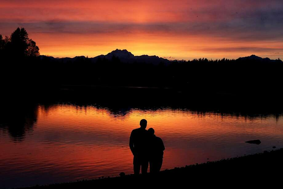 All right, Washington, we get it. You have nice sunsets: Justin Adrian and his wife, Hillary, watch the sunset together at the Pat Carey Vista in East Bremerton, Wash. Photo: Larry Steagall, Associated Press