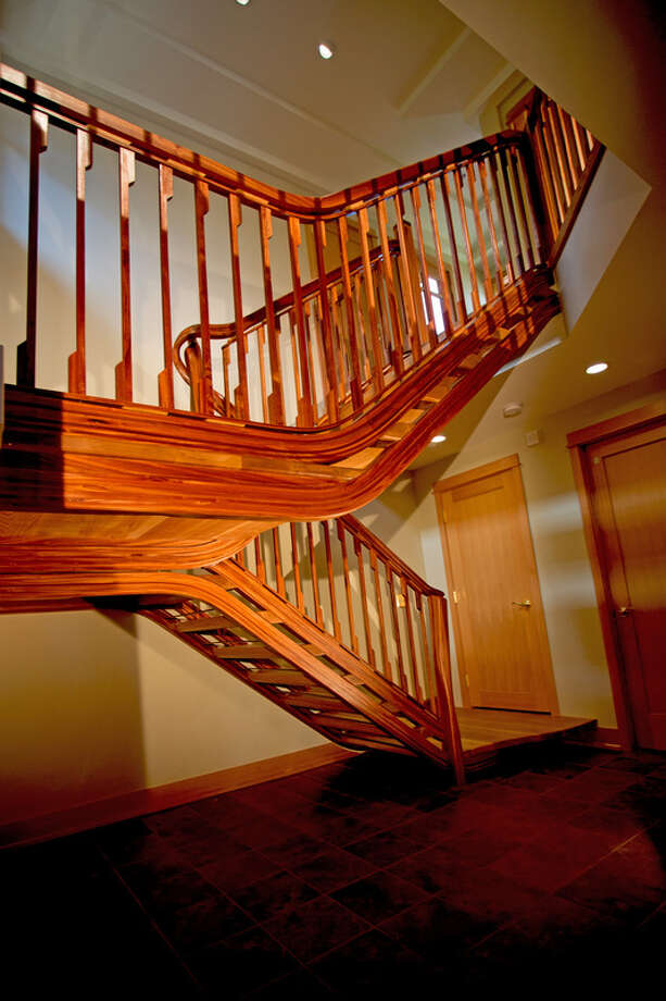 "NK Woodworking's ""Straight Curves"" custom open riser staircase won the 2014 Stairway Manufacturers' Association Staircraft Awards for Best Straight Stairway, Most Unique Stairway and Best Stair Part, for the stringers. It is made of white oak and sapele. Photo: Nathie Katzoff"