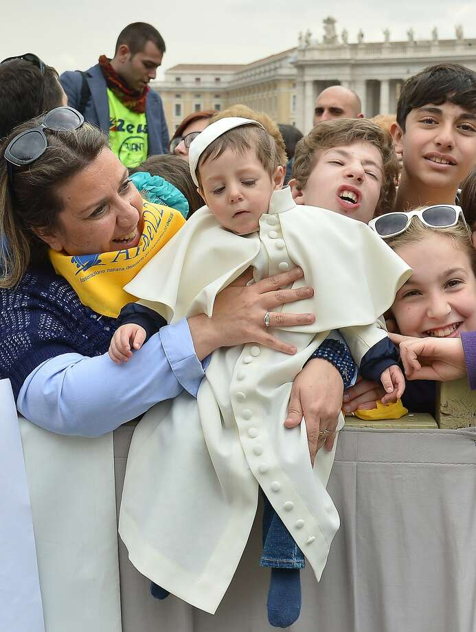 Now His Holiness will have to kiss you! A little Roman boy is thrilled to be dressed as the pope before the pontiff's weekly general audience in St. Peter's Square at the Vatican. Photo: Alberto Pizzoli, AFP/Getty Images