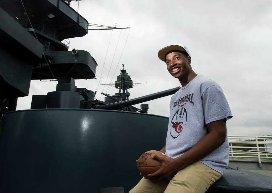 Port Arthur Memorial's Trenten Swinton poses on the Battleship Texas on Wednesday afternoon in La Porte, Texas. Swinton will be the first player from the school to play for the the Naval Academy. He begins his college and Naval career on July 22. Photo taken Wednesday, 4/2/14 Jake Daniels/@JakeD_in_SETX Photo: Jake Daniels / ©2014 The Beaumont Enterprise/Jake Daniels