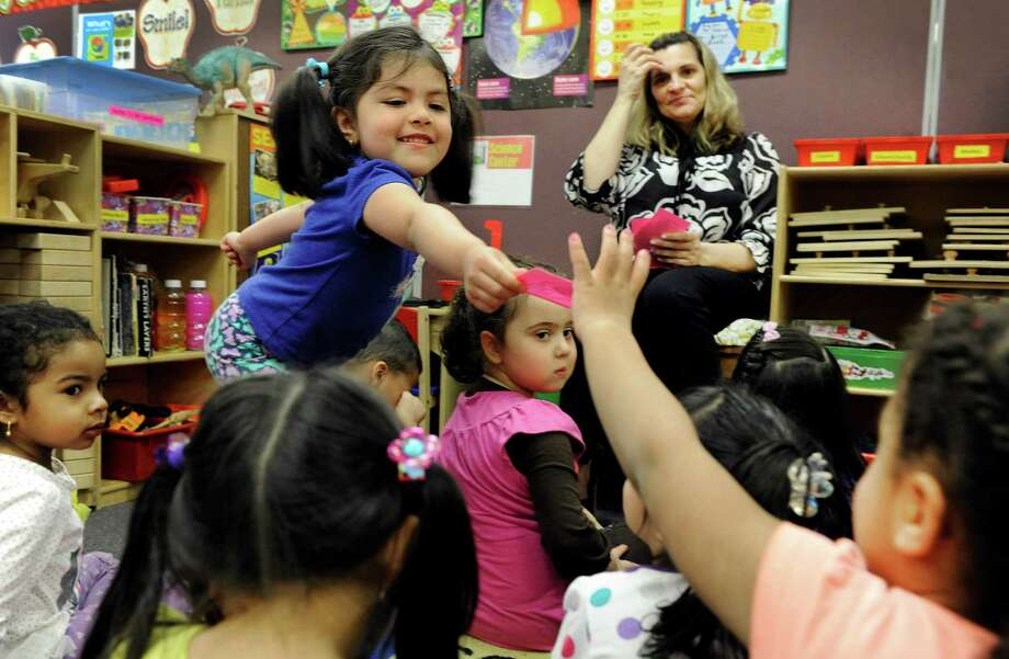 Brittney Garcia, 4, partcipates in an exercise that teaches children to recognize numbers at the Salvation Army - The Right Place, a pre-school funded by the state school readiness grant the city receives, Wednesday, April 9, 2014. Photo: Carol Kaliff / The News-Times