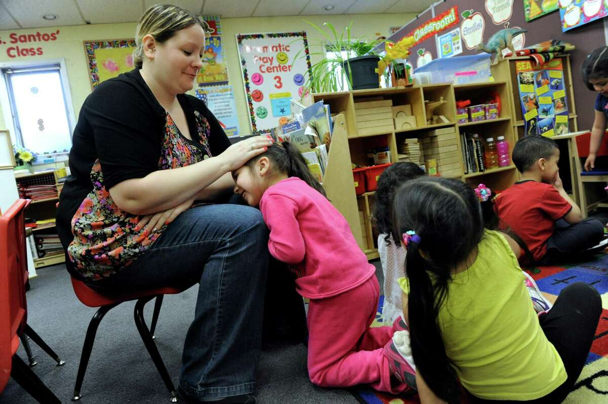 Teacher Kelly Black gives some encouragement to Daisy Cordova, 3, at the Salvation Army - The Right Place preschool in Danbury, Conn. Wednesday, April 9, 2014. The schoo is funded by a state readiness grant the city receives.